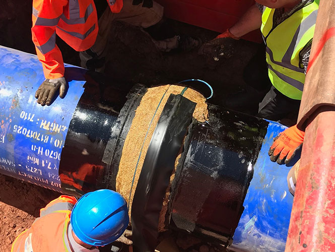 Densoclad Tape applied over Denso Profiling Mastic on pipe flange