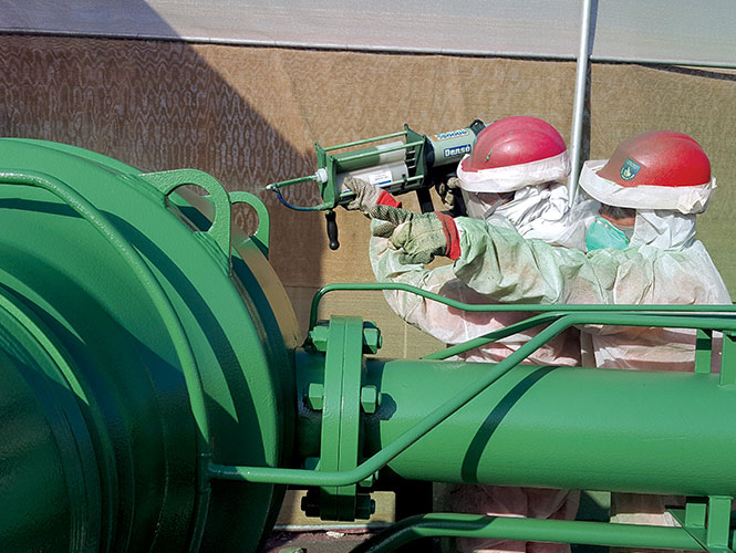 Protal 7200 being spray applied to a pipe