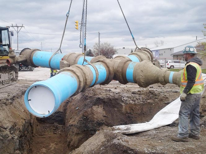 Denso LT Tape applied to wastewater pipelines in arctic temperatures