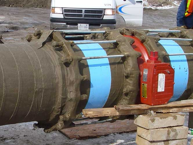 Densyl Tape protecting waterwork joint restraint flanges from corrosion