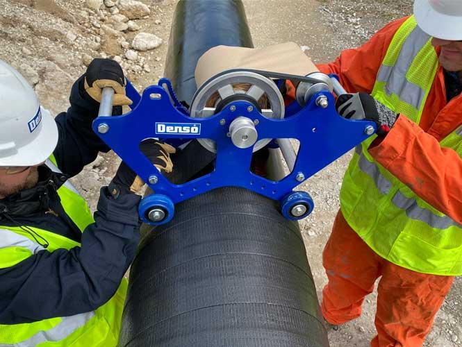 Workers performing pipeline maintenance
