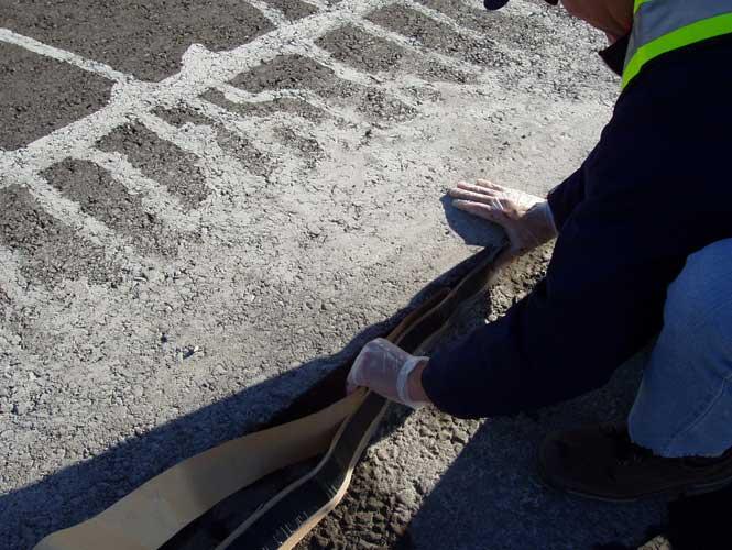 Denso Re-Instatement Tape application to existing asphalt